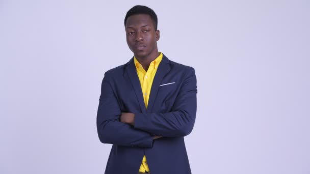Young angry African businessman with arms crossed