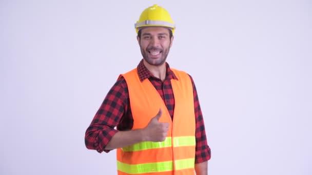 Šťastný vousatý Peršan muž dávatel palce
