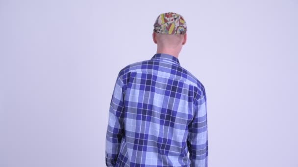 Rear view of young hipster man thinking and waiting