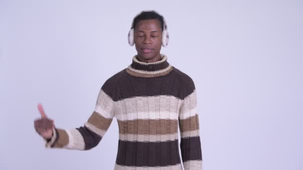 Young stressed African man giving thumbs down for winter