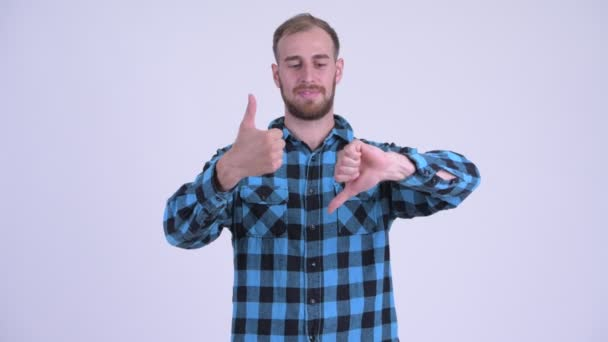 Confused bearded hipster man choosing between thumbs up and thumbs down