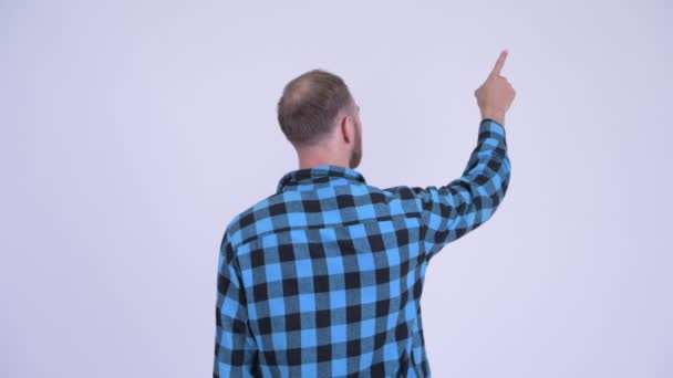 Rear view of bearded hipster man pointing finger