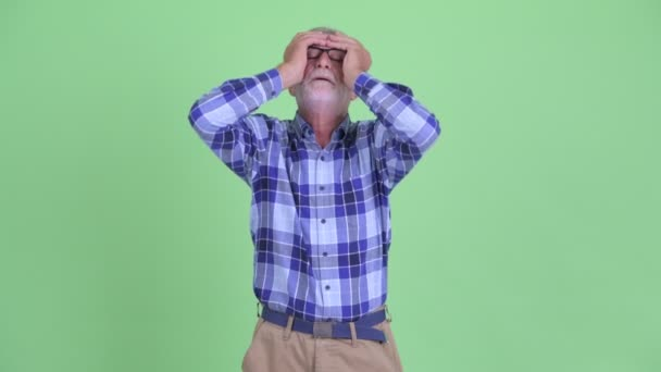 Stressed senior bearded hipster man getting bad news