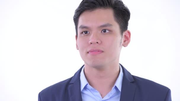 Tváří v tvář šťastným mladým asijským obchodníkovi