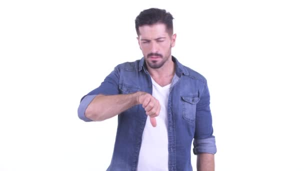 Angry young bearded hipster man giving thumbs down