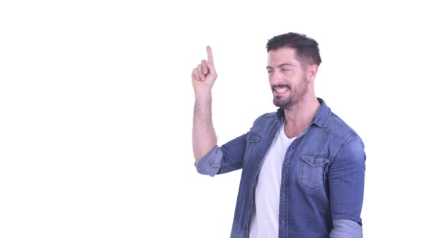 Happy young bearded hipster man thinking and pointing up