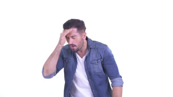 Stressed young bearded hipster man getting bad news
