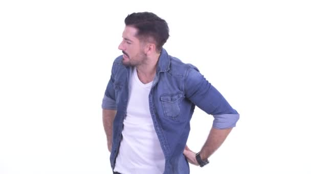 Stressed young bearded hipster man having back pain