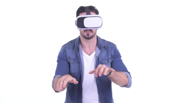 Happy young bearded hipster man using virtual reality headset