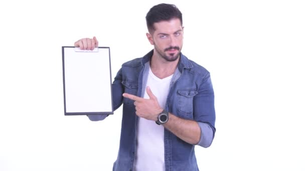 Stressed young bearded hipster man showing blackboard and giving thumbs down