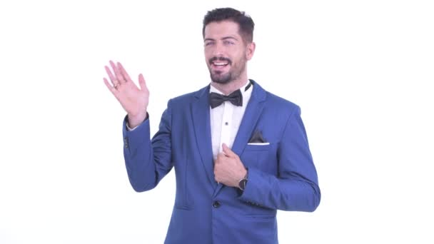 Happy young handsome bearded businessman waving hands