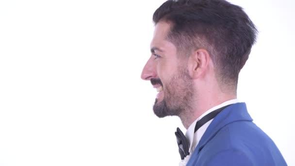 Profil closeup pohled na šťastného mladého vousatého obchodníka, který mluví