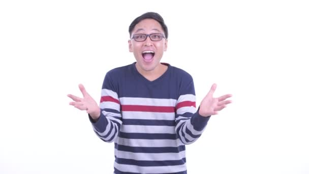 Happy Japanese hipster man with surprise gesture