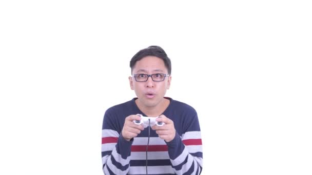 Face of Japanese hipster man with eyeglasses playing games