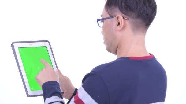 Closeup rear view of Japanese hipster man using digital tablet