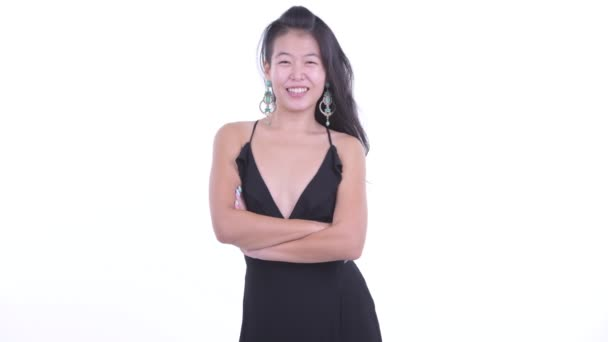 Happy beautiful Asian woman smiling with arms crossed