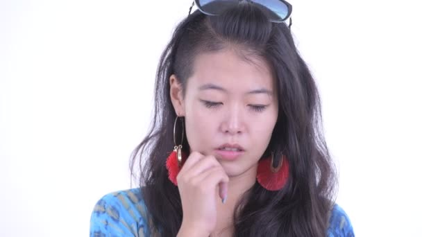 Face of stressed Asian tourist woman thinking and looking down