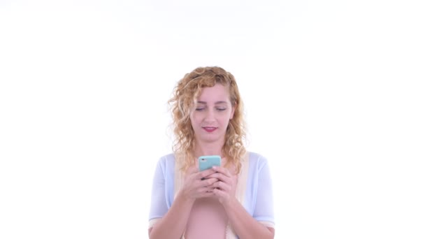 Happy beautiful blonde woman using phone and looking surprised