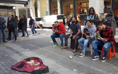 Athens, Greece - November 24, 2018: Musicians play music on famous Ermou street in Athens, Greece