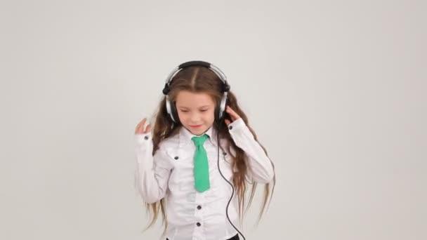 Little girl in big headphones.