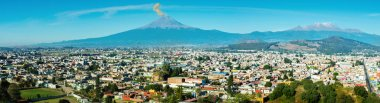Eruption of Popocatepetl Volcano over the town of Puebla, Mexico, panoramic view