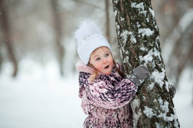 little girl on walk in winter park, outdoor