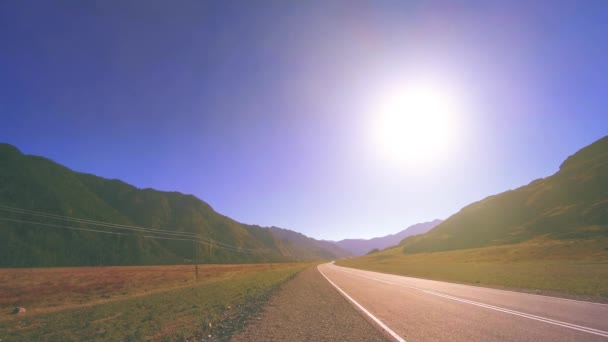 Mountain road timelapse at the summer or autumn sunset sunrise time. Wild nature and rural field.