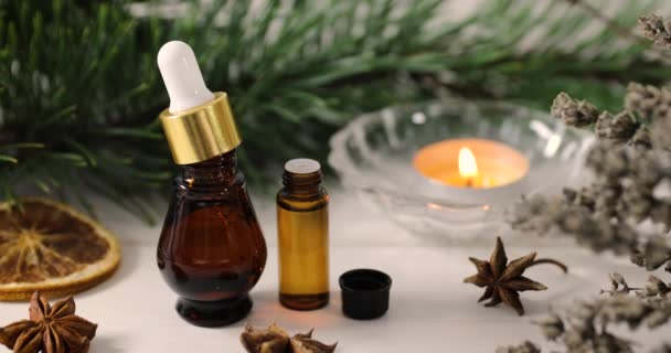 spa and wellness - organic essential oils with aromatic plants and candle