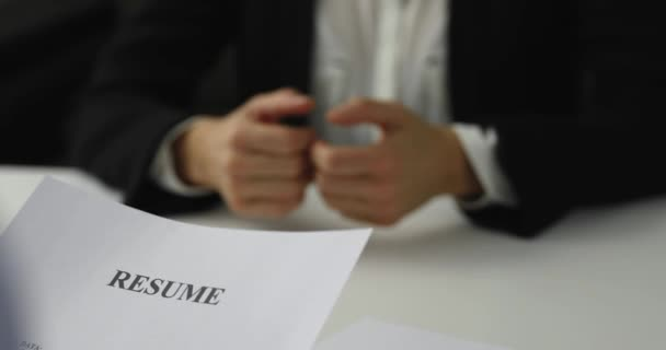 hiring manager interviews a woman in a job interview reviewing resume