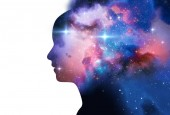 silhouette of virtual human with aura chakras on space nebula 3d