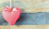 Fotografie Heart decoration object on wooden background