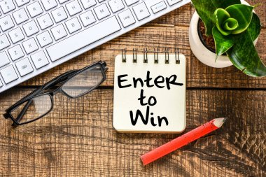 Enter to win business concept on table by laptop