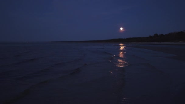 Big huge Moon illuminates the sea with a moon light trail - 4K professional footage landscape - Eastern Europe
