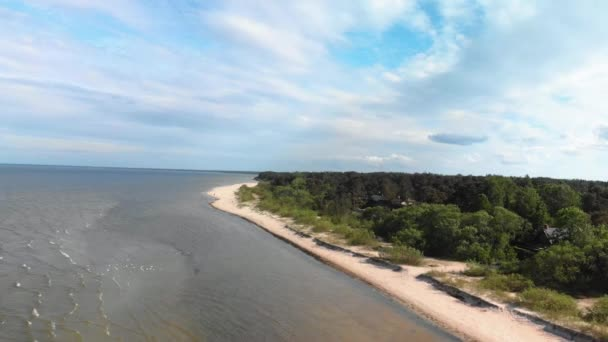 Aerial flying over beautiful white paradise sand beach in Latvia and the Baltic Sea Gulf