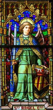 Valencia, Spain - June 15, 2018: Stained Glass in Valencia Cathedral, Valencia, depicting an Angel with a Sword