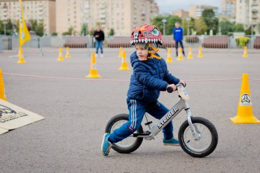 Russia, Moscow, Gorky Park, September 09, 2017. Children's bike ride. Children from 2 years to 7 in helmets compete in bike race