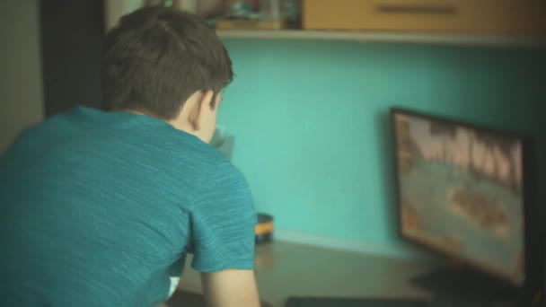 children play computer in video games. boy and girl kids play online video games slow motion the video. kids play video lifestyle game concept