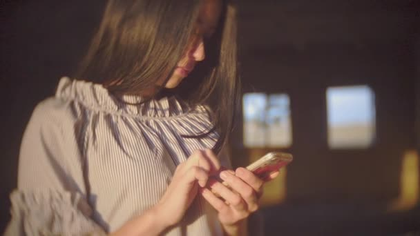 Young woman sitting using smartphone in coffee cafe, urban women lifestyle technology, vintage style chat using smartphone outdoors the video photo for social media. girl brunette slow motion. girl