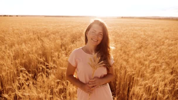 portrait beautiful woman smiling. girl fashion model in slow motion video white dress on field wheat. sexy woman on nature in lifestyle the field grass flowers summer. agriculture. girl length
