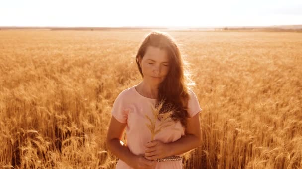portrait beautiful woman smiling. girl fashion model in slow motion video white dress on field wheat. sexy woman on nature in field grass flowers summer. lifestyle agriculture. girl length portrait