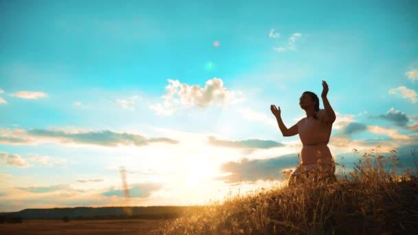 Woman on her knees praying