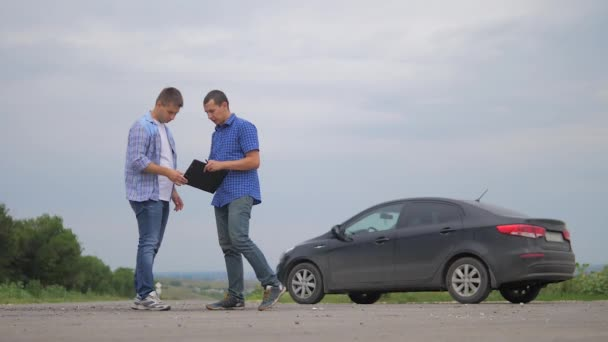 man test drive car.two men make deal. man seller driver makes car the auto insurance slow motion video sale sells used cars. Buying rent a car lifestyle . man car insurance sale of used cars concept
