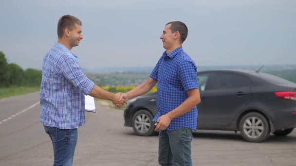 two men make a deal. man seller driver makes car the auto insurance slow motion video. man sale sells used cars. car insurance sale of used cars concept. Buying rent a lifestyle car