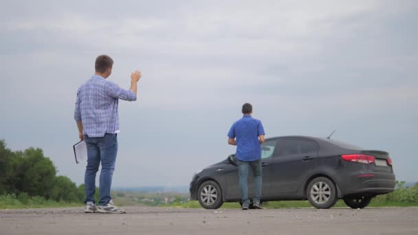 two men make deal. man seller driver makes car the auto insurance slow motion video sale sells used cars. Buying rent a car . man car insurance sale of used cars lifestyle concept