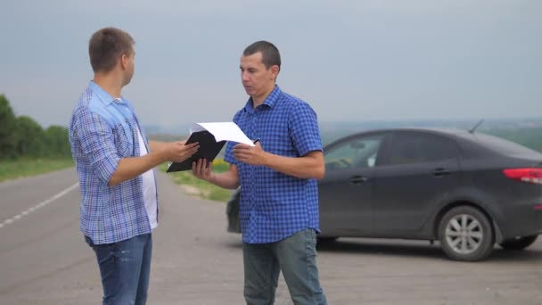 two men make a deal. man seller driver makes car the auto insurance slow motion video. man sale sells used cars. car insurance sale of used cars concept. Buying rent a car lifestyle