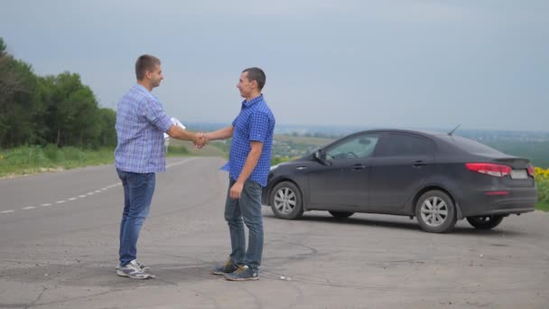 two men make a deal. man seller driver makes car the auto insurance lifestyle slow motion video sale sells used cars. car insurance sale of used cars concept. Buying rent a car