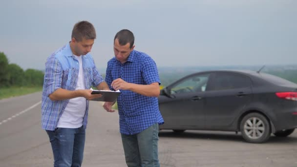 two men make a deal. man seller driver makes car the auto insurance slow motion video. man sale sells used cars. car insurance sale of used cars lifestyle concept