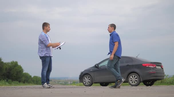 two men make lifestyle a deal. man seller driver makes car the auto insurance slow motion video sale sells used cars. car insurance sale of used cars concept. Buying rent a car