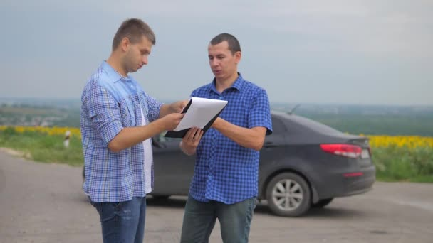 two men make a deal. man seller driver makes car the auto insurance slow motion video. man sale sells used cars. car insurance sale of used lifestyle cars concept. Buying rent a car