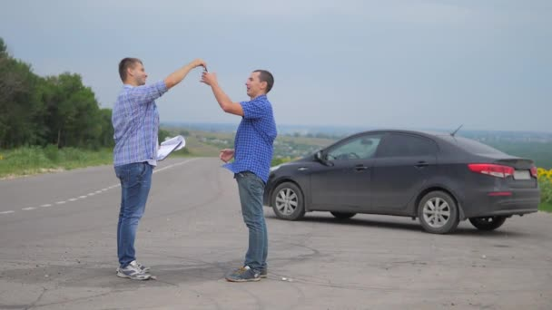 two men make a deal. man seller driver makes car the auto lifestyle insurance slow motion video sale sells used cars. car insurance sale of used cars concept. Buying rent a car